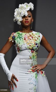 Models present creations by Ivorian designer Gilles Toure during the 'Afrik' fashion show in Abidjan on June African Wedding Dress, Ankara Gowns, Stylish Clothes For Women, Ivory Coast, African Design, Ivoire, Ankara Styles, Fashion History, Fashion Boutique