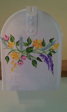The front of the custom hand painted floral wedding mailbox
