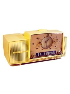 Radios--Yellow Plastic Tabletop Clock Radio