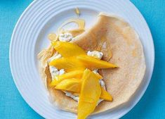 Lush, ripe mango gives panckaes a fresh, tropical topping and honey the sweetest finish