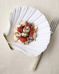Elevate the sophistication level of your shower menu with this ceviche -- a dish made with marinated raw fish (we added pink grapefruit in this version). This bay scallop ceviche will feel right at home served in a seashell, and you'll feel secure knowing that these particular shells are food-safe. White Irish scallop shells, Conch King.