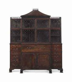 A GEORGE II MAHOGANY SECRETAIRE BOOKCASE CABINET THE CENTRAL LOWER SECTION MID-18TH CENTURY, THE FLANKING DRAWERS AND UPPER SECTION PROBABLY LATE 18TH/EARLY 19TH CENTURY   92 in. (233.7 cm.) high, 77 ½ in. (196.9 cm.) wide, 18 in. (45.7 cm.) deep