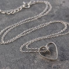 A flat sterling silver wire is carefully and creatively fashioned into the shape of a heart and cleverly suspended from a sterling silver chain. #Otisjaxon #Jewellery #heart #Women #Giftforher #Accessories