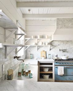 French inspired vintage modern farmhouse kitchen from Dreamy Whites with blue Lacanche range