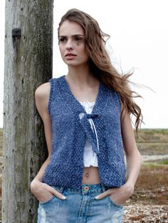 Knit this womens stocking stitch waistcoat from Summer Textures, a design by Sarah Hatton using the beautiful yarn Summer Tweed (silk and cotton). With moss stitch bands and a tie fastening detail, this knitting pattern is for the beginner knitter.