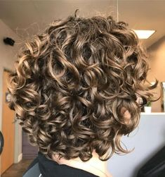 """Dark-Blonde Short Curly Hairstyle Bronde hair colors are great in-between shades that don't require too much commitment or maintenance. Pairing this hairdo with bangs and """"wet"""" styling for wavy hair is sure to turn heads. Curly Hair Styles, Haircuts For Curly Hair, Short Wavy Hair, Curly Hair Cuts, Medium Hair Cuts, Haircut Medium, Haircut Short, Short Undercut, Hairstyle Short"""