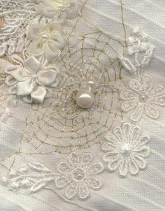 White on white crazy quilt with bead spider