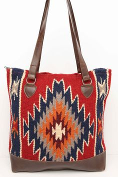 """Handwoven 100% Wool panels in classic Zapotec styles and eye catching colors with  Durable Grade 'A' soft faux leather bottom, comfortable sturdy handles. Zipper closure, fully lined with an inside pocket Approx 15"""" X16"""""""
