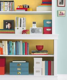 Style a bookcase with unexpected items, like an eye-catching antique or a porcelain statue. | Find inspiration for your own shelves and bookcases in these great photos.