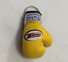TWINS Keychain Twins Special VERY GOOD QUALITY Made in Thailand  Contact: MMA-MUAY THAI FIGHT SHOP    Pin BBM: 7FAFB9ED   /Whatsapp: +6282140883852  LINE: mmamuaythaifightshop  #gloves#boxinggloves#keychain#keyring#handwraps#wraps#gantungankunci#twins#thailand#twinsshop#boxer#kickboxing#thaiboxing#mma#bjj#sarungtinju#tinju#mmagloves