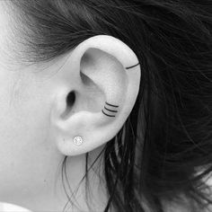 line tattoos in ear and on ear