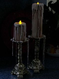Black candles dripping wax