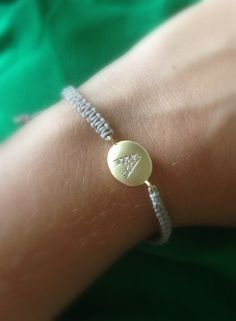 adjustable string bracelet gold plated over brass with cz stones