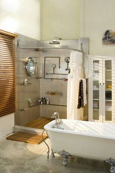 Porthole window in shower with cool plumbing. Teak shower floor and bathmat is a nice touch too. Industrial Showers, Industrial House, Bathroom Renovations, Bathroom Ideas, Bathroom Showrooms, Bathroom Stuff, Bathroom Showers, Remodel Bathroom, Bathroom Designs
