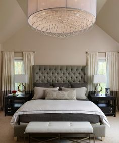 Windows behind night stand, light curtains, fixtures hidden behind crown moulding