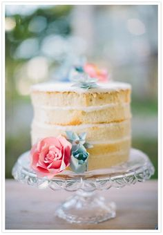 white layer cake from French Kiss Pastries & paper flower cake topper by Thrifty Chic Love.