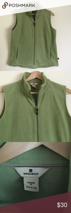 Woolrich M polar fleece zip up vest green Stay warm in this fun casual will rush zip up polar fleece vest and a beautiful granny Smith apple green color. Best features zip up front with two pockets and front and back fitted darts dimensions taken while garment is laying flat: 15 inches across shoulders, 40 inches across bust, 40 inches at waist, 42 inches, length from shoulder to bottom hem is 24 inches in the front and 26 inches in the back Woolrich Jackets & Coats Vests