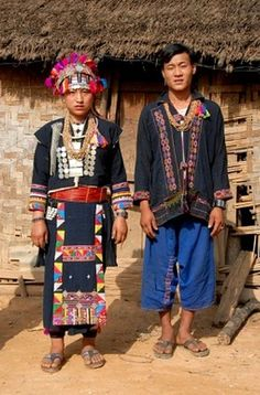 Laos | Akha Loma man and woman wearing traditional clothing. Ban Noy, Phongsali Province | ©Imagebrokerrm