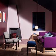 Danish brand Carl Hansen & Son built a mock apartment featuring rich colours and mid-century furniture for its Salone del Mobile installation in Milan