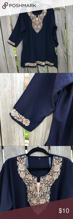 Indian Tunic from India Beautifully embroidered tunic from India. Never worn. Gold embroidery on chest, sleeves and bottom hem. Navy blue in color. Soft fabric. Tag says 3XL but would fit a 2XL comfortably. Tops Tunics