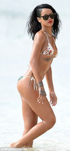 Singer Rihanna wears a sexy string bikini