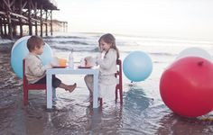 Holiday at the beach with giant balloon