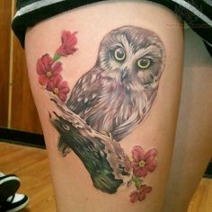 Owl Tattoo. I like this realistic look of this owl, and the flowers