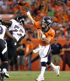 Peyton Manning- QB pictured with Terrell Suggs, LB.  Manning's 7 Touchdowns lead Broncos past Ravens, 49-27.