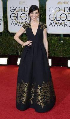 Credit: PAUL BUCK/EPA Everything co-ordinates wonderfully on Julianna Margulies's Andrew Gn dress. The deep V, the gold on ...
