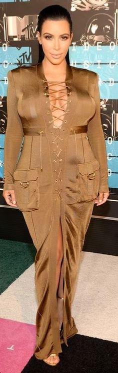 Who made Kim Kardashian's green lace up green gown?