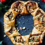 Golden puff pastry wreath filled with sweet cranberry sauce, oozy Brie cheese and pistachios is a fantastic addition to your holiday cheese board.