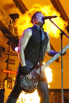 Skillet is the loudest, pyro-intensive, sleeveless shirtiest, rocks shows out there.  You should see them live...AMAZING!