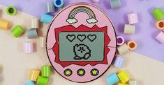 [TOPITRUC] Un pins Kirbygotchi un mélange entre Kirby et un Tamagotchi Pin