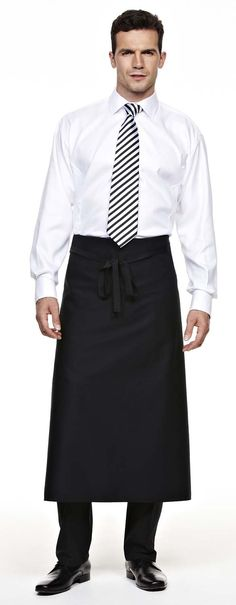 Royal staff white shirt with long black apron over black pants.  Possibly black tie?