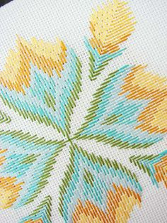 cross-stitch yellow green flower. interesting twist on cross stitch. also, awesome blogger at aesthetic outburst