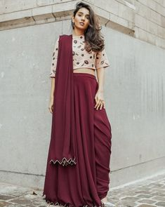 A Draped Maroon Saree with Embellished perfect for a mehndi occasion for Bridesmaid. Indian Outfits Modern, Indian Wedding Outfits, Indian Fashion Bloggers, Fashion Blogger Style, Indian Bridesmaids, Bridesmaid Outfit, Wedding Dresses For Girls, Girls Dresses, Long Choli Lehenga