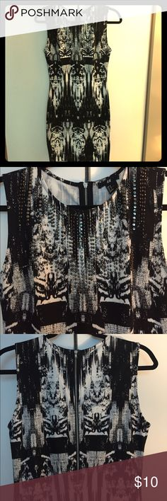 """H&M sleeveless cotton dress w silver embellishment Cotton black & white sleeveless dress from H&M. Has silver embellishment on the front and exposed silver zipper up the back. Size Medium. Hits mid-thigh on me and I am 5'8"""". H&M Dresses Mini"""