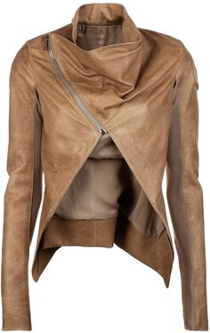 Totally unique triangle cut out in the middle of this light brown leather short jacket! Love the mock collar too.