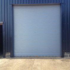 Power operated insulated industrial roller shutter door to storage unit galvanised finish www.worcesterdoors.co.uk