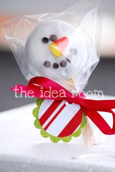 Snowman cookie pop. Save candy corn to use for nose.