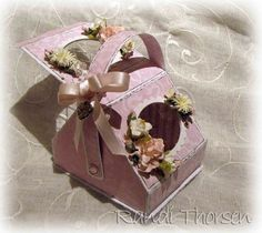 Basket / Purse box - kind of reminds me of a lunch basket even though it's decorated with a pink flower theme.