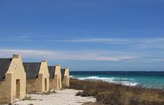 Former slave houses on the shore of Bonaire in the Caribbean.