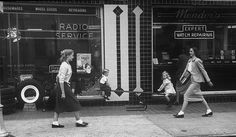 A pair of teenagers, both sporting bobby socks, walk towards each other on a business lined street in 1947. What I especially love about this shot - aside from the gals' fashions - is the children playing on a seesaw that just happens to be on the sidewalk, and the juxtaposition between childhood and teen years that it lends this wonderful image. #vintage #1940s #fashion