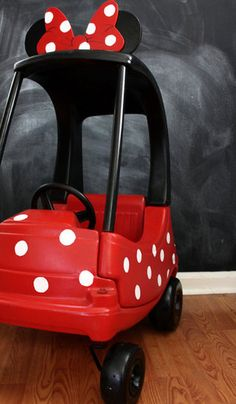 """""""Minnie"""" Couper?: """"The Minnie Mobile! Chloe calls it her 'Minnie Bow-bile.' Isn't it adorable,"""" Kristin says. """"My mom made it from a yard sale Cozy Coupe. She spray painted it, added polka dots, and had her friend help cut out and screw in the rubber ears and bow.""""  Source: The Hunted Interior"""