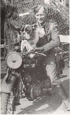 """A Canadian wearing 'Silver Leaf' wellies on his """"Snortin' Norton"""" with his """"dribblin' bulldog"""""""