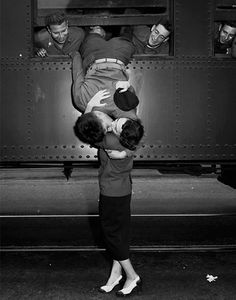 One of the most romantic photographs of all time? A solider kisses a young woman goodbye before leaving to go to war.