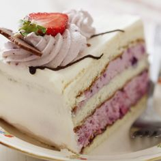 A delicious white layered cake recipe mixed with strawberry mousse and buttercream icing.