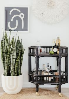 Cocktail anyone? A black cane bar cart makes a fun and festive statement in this airy living room in Sydney's Northern Beaches. Styled by Cote Interiors. Diy Bar Cart, Bar Cart Styling, Dining Room Chairs Ikea, Eames Chairs, Cafe Bar, Black Bar Cart, Bar Trolley, Bar Carts, Drinks Trolley