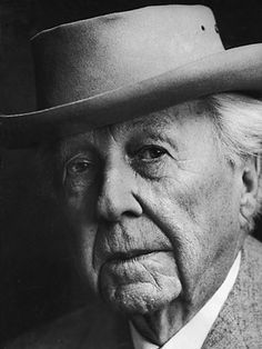 Frank Lloyd Wright designer of buildings and total environments (his wife didn't like it when he designed her clothes.)