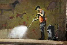 graffiti removal. banksy.